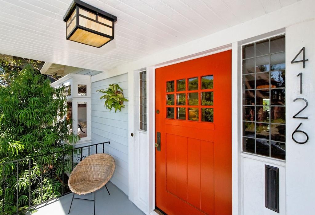 Front enrance with an orange door