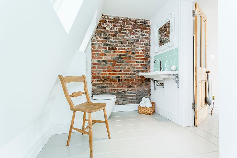 Front of an old chimney breast turned into a feature brick wall in the beach style bathroom [Design: Westcott Construction]