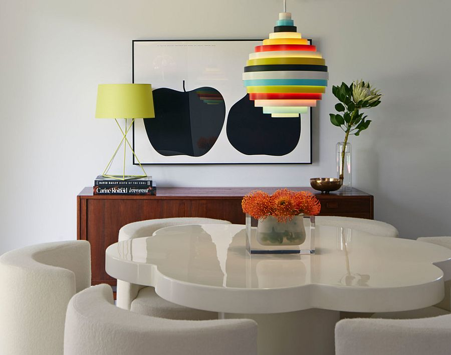Fun lighting fixtures bring color to the midcentury dining room [Design: Alison Damonte Design]