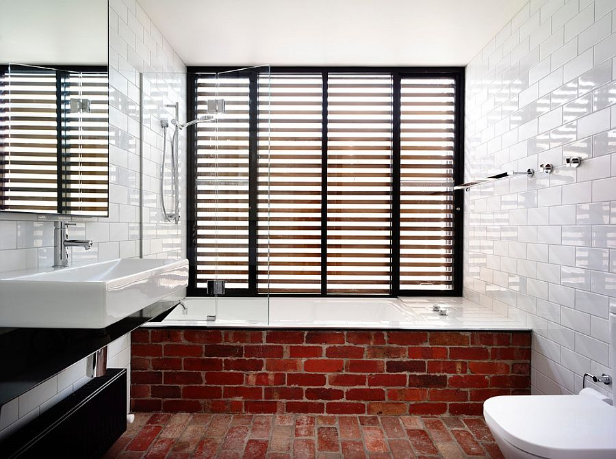 Fun way to showcase exposed brickwork in the modern bathroom [Design: Wolveridge Architects]