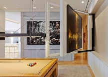 Game room with hidden TV compartment