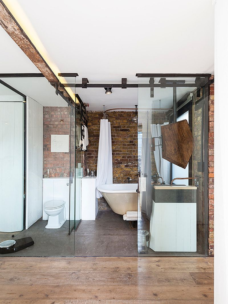 Glass and brick fashion a lovely fusion of contemporary and industrial styles in the bathroom [From: Nathalie Priem Photography]