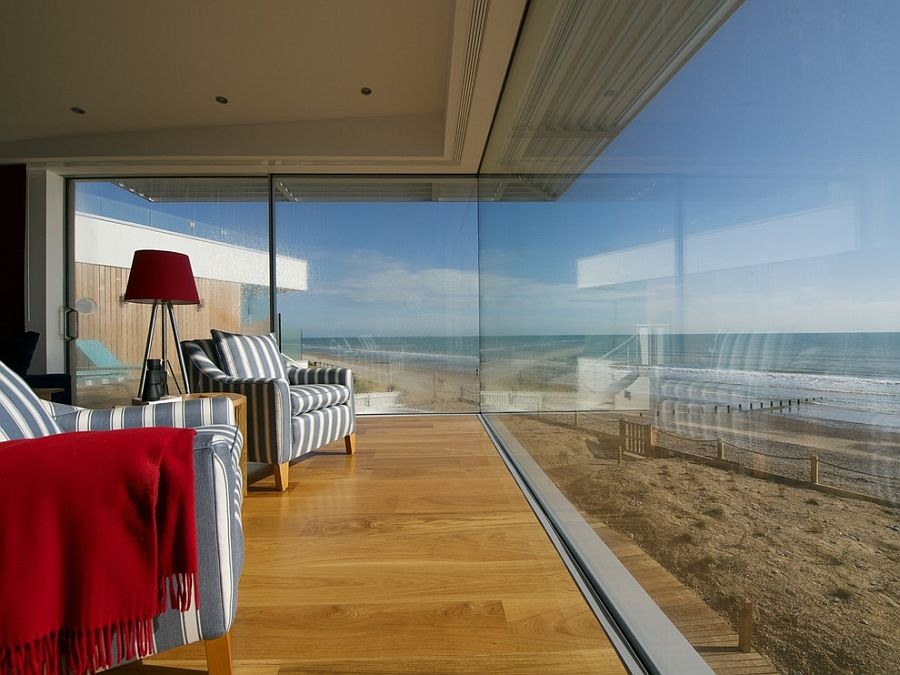 Glass walls completely open up the living room to the ocean view on offer [Design: Hazle McCormack Young]