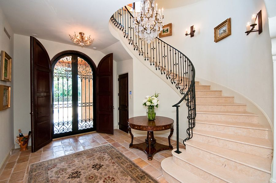 Gorgeous double door entry and spiral staircase [Design: Robelen Hanna Homes]