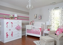 Gray and white nursery with a hint of pink