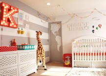 Gray and white striped accent wall is a popular choice in the gender neutral nursery