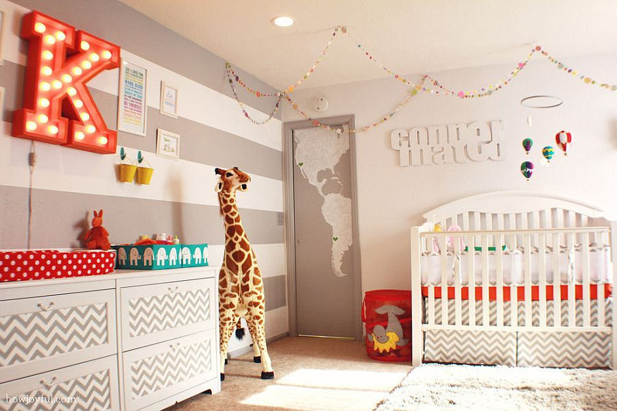 Gray and white striped accent wall is a popular choice in the gender neutral nursery [Design: How Joyful Design Studio]