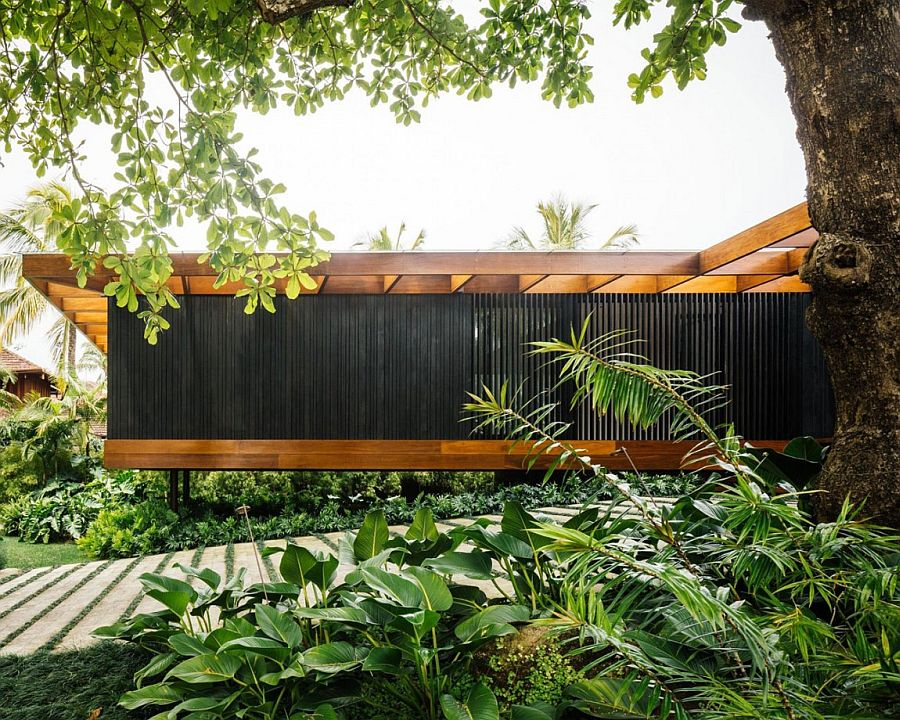 Greenery fills the entrance of House RT in Rio