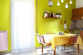 Greenish-yellow backdrop in the dining room is easy to replicate