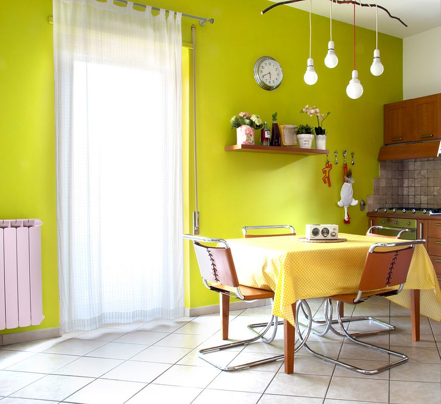Greenish-yellow backdrop in the dining room is easy to replicate [Design: Spazio 14 10]