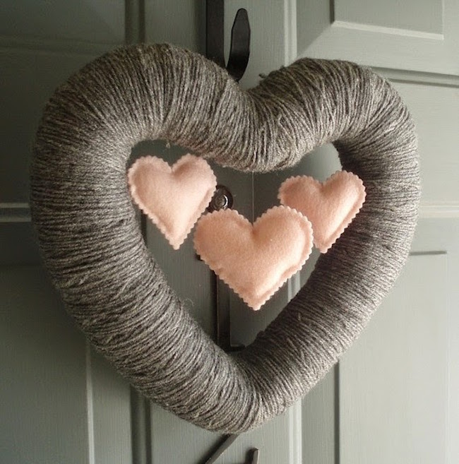 Heart-shaped Valentine's Day wreath made from yarn with mini hearts