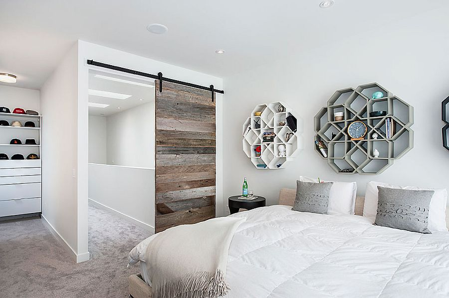 Hexagonal shelves above the bed provide visual and textural contrast
