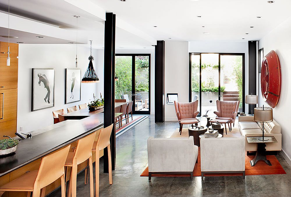 Iconic midcentury decor creative artwork and industrial lighting shape the open plan living area