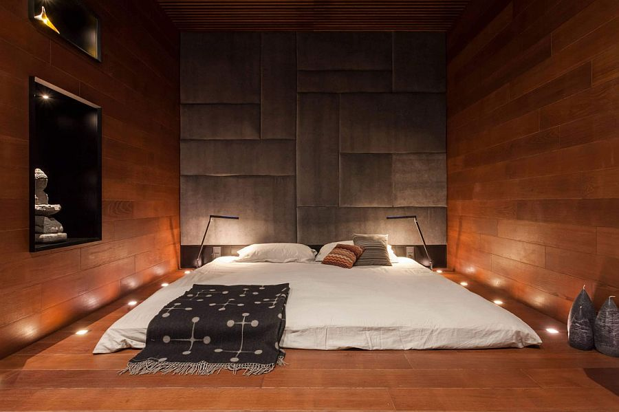 In-ground lighting around the beds adds another dimension to the minimal bedroom