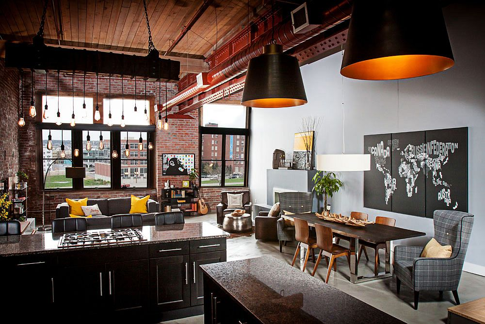 Industrial kitchen and living area of loft with exposed brick walls
