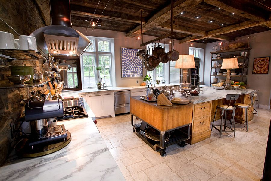 Industrial kitchen with large, unique table lamps [Design: Jarrett Design]