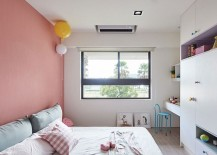 Kids' bedroom with a pink accent wall