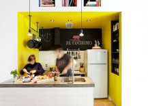 Kitchen adds a dash of yellow and black to the home along with chalkboard walls
