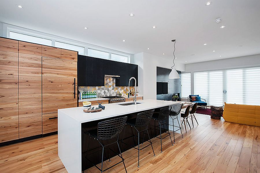Kitchen, dining area and TV room combine to create the family zone on the top level