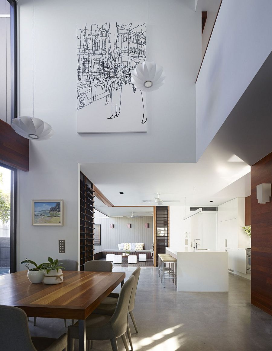 Kitchen, dining area and courtyard on the lower level of Newstead home