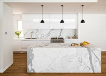Kitchen with marble and hanging pendant lights