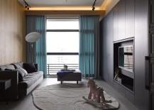 Large-window-brings-light-into-the-modest-dark-living-room-217x155