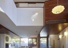 Lighting above the dining table accentuates the vertical space on offer