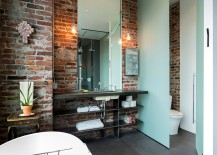 Lighting in the bathroom accentuates the beauty of exposed brick walls