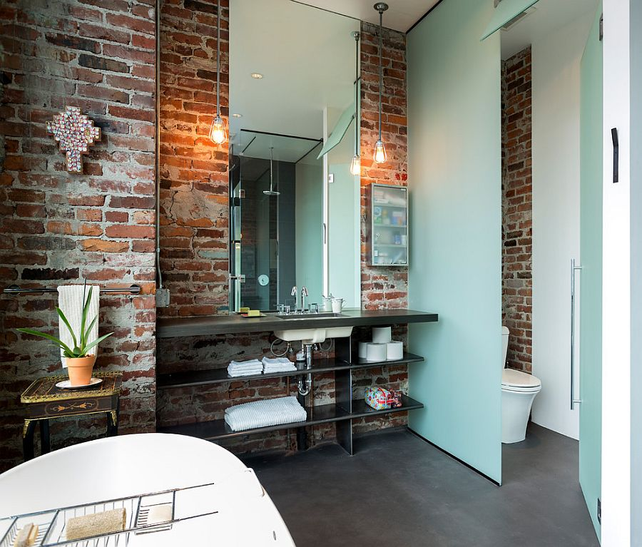 ... Lighting in the bathroom accentuates the beauty of exposed brick walls  [Design: Crescent Builds