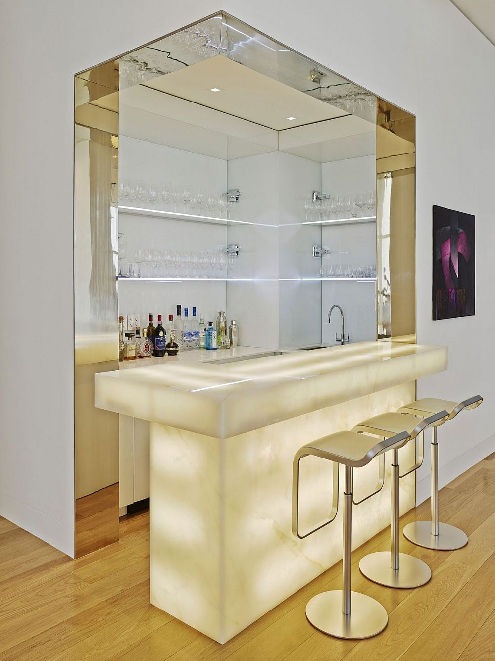 Lighting steals the show at this beautiful home bar