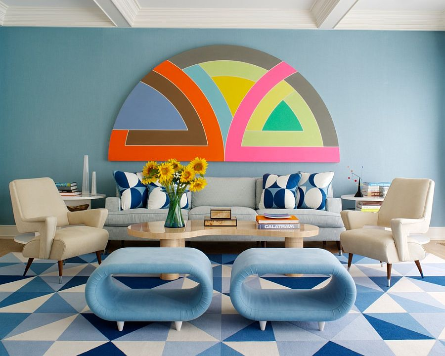 Living room draped in blues with a hint of pink and orange
