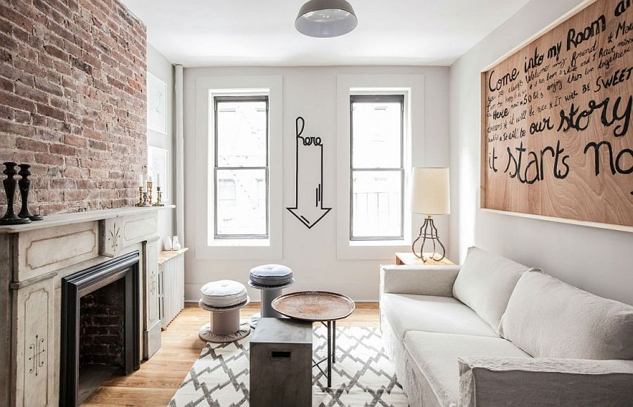 Living room of lovely New York apartment with brick wall