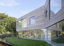 Lower level of the family home is completely clad in glass walls and floor-to-ceiling doors