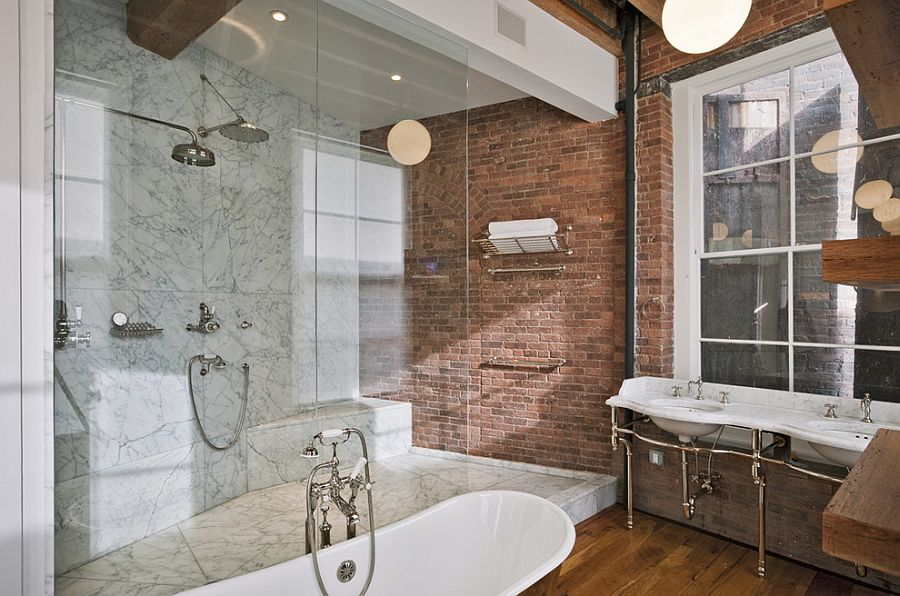 Marble and brick come together inside this industrial bathroom [From: Jane Kim Design / Photography by Eduard Hueber]