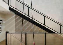 Metal-screened-stair-backed-by-a-tiled-feature-wall-217x155