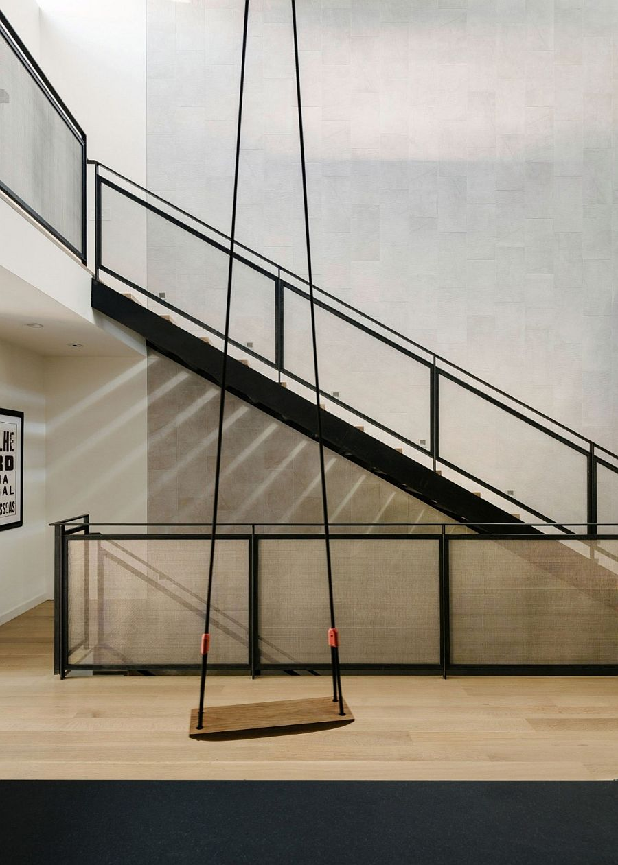 Metal-screened stair, backed by a tiled feature wall