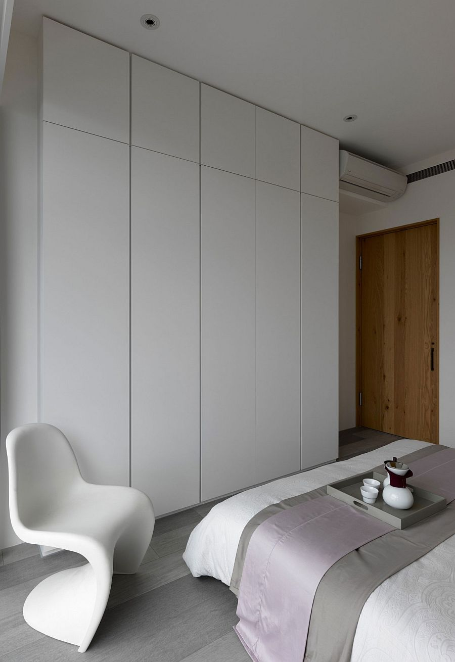 Minimal white wardrobe for the small contemporary bedroom