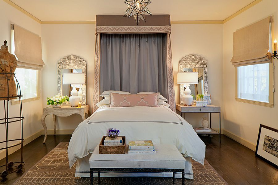 Mirrors accentuate the beauty of the table lamps in this Mediterranean bedroom [Design: Laura Martin Bovard]