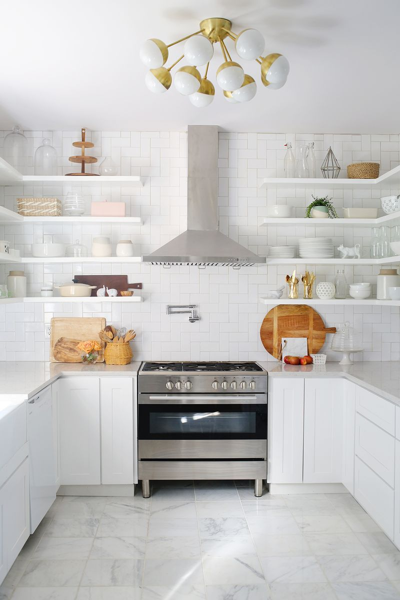 Mixed materials kitchen with a patterned backsplash