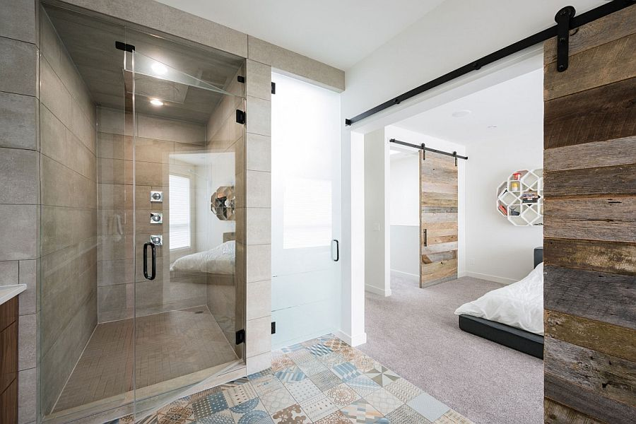 Modern bathroom connected with the bedroom using barn door
