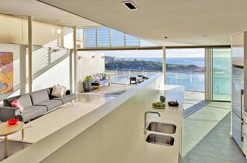 Modern kitchen and living room of beachside private residence in Sydney