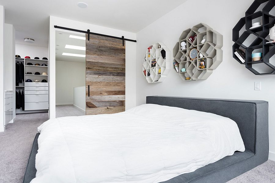 Modern minimal master bedroom with sliding barn door