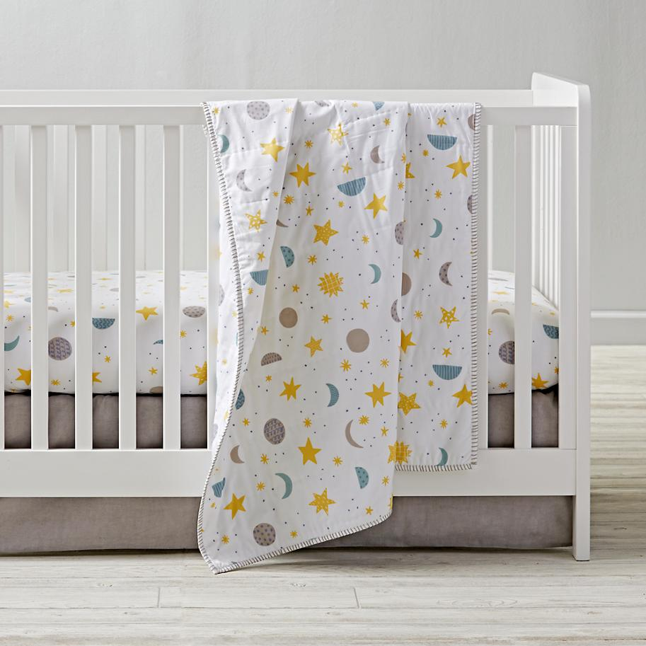 Moon, star and sun crib bedding from The Land of Nod