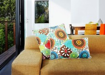 Neutral backdrop of the gardenhouse is enlivened by colorful decor and accessories