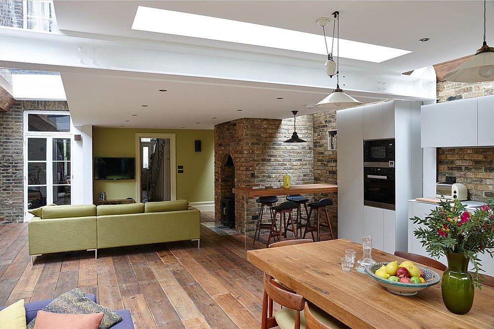 Open plan living area with kitchen and dining of the revamped London home