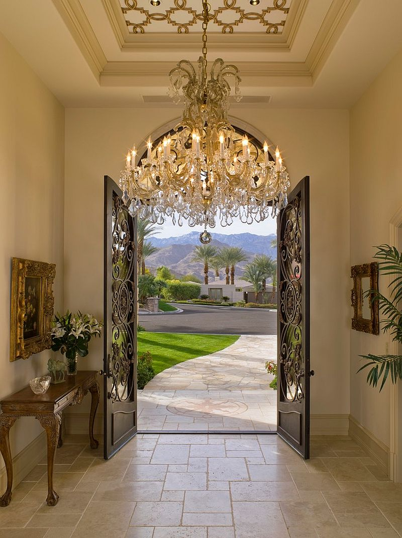 Ornate ceiling and sparkling chandelier fit in with the Mediterranean theme [Design: SoCal Contractor]