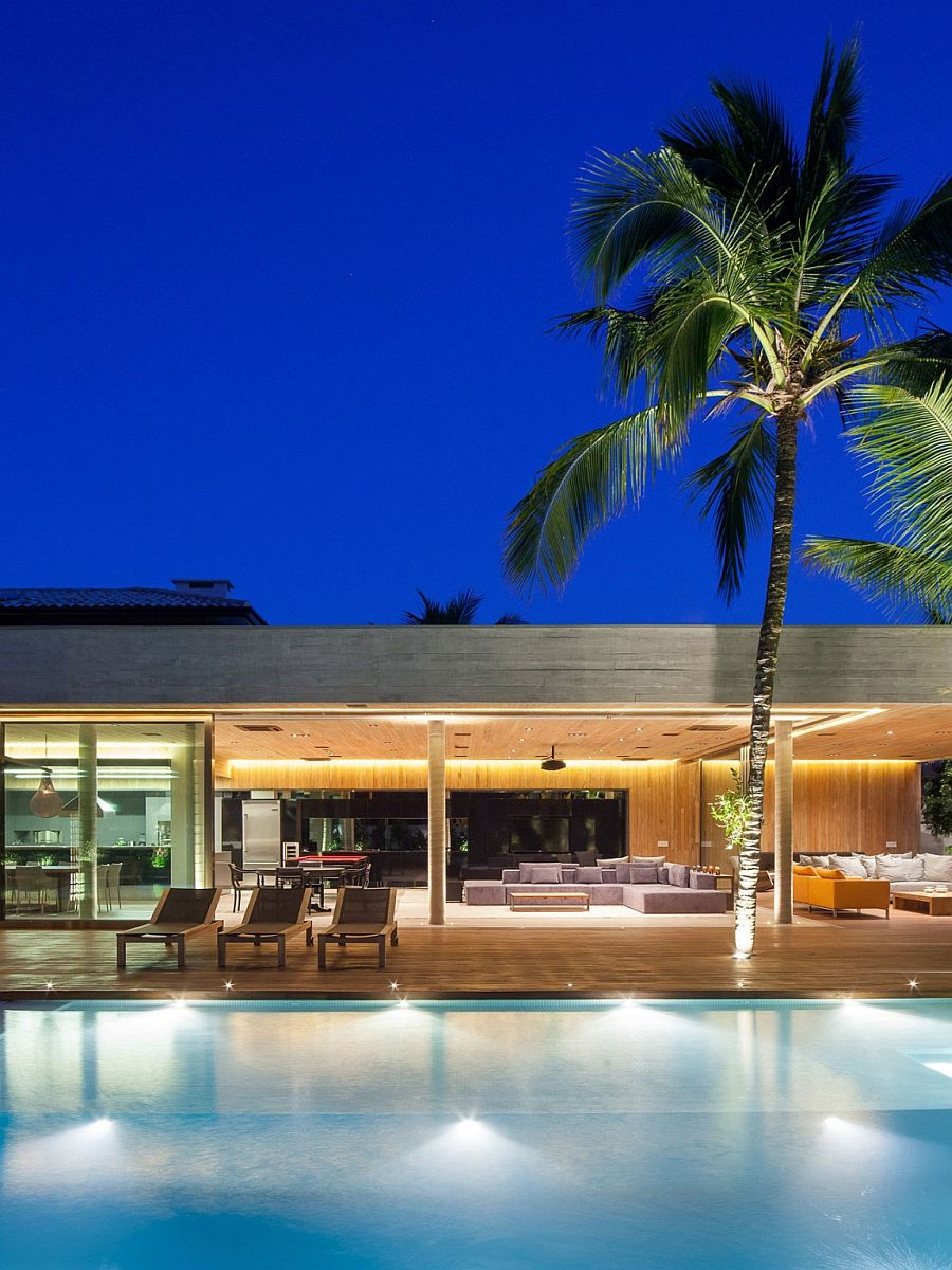 Outdoor in-ground lights around the pool create a dazzling ambiance