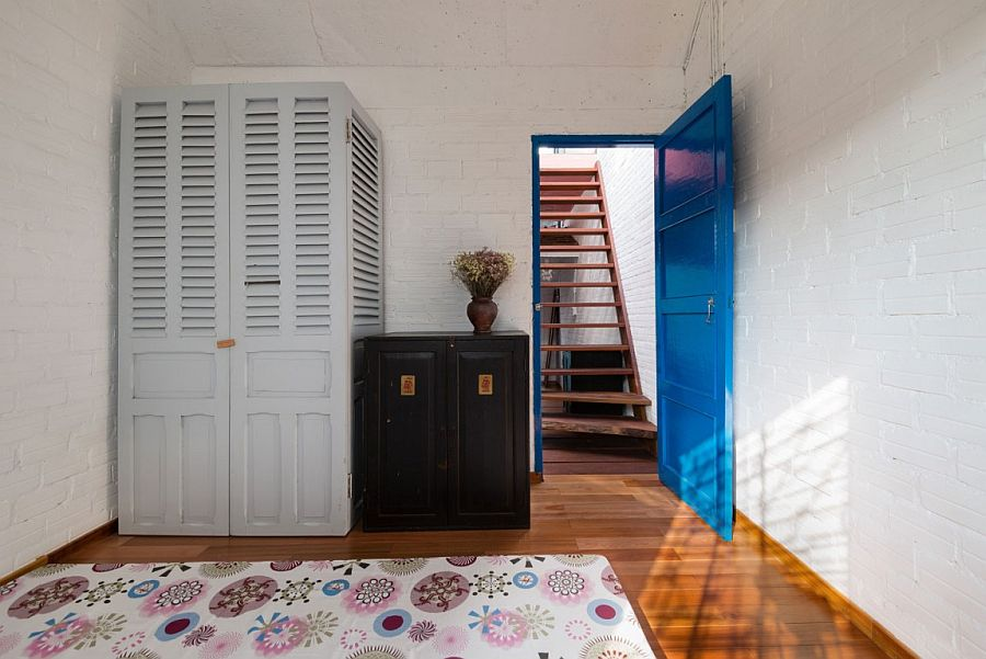 Painted door adds a splash of blue to the neutral interior