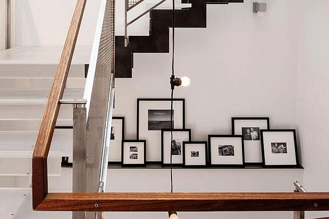 Picture ledge with a collection of black and white photographs