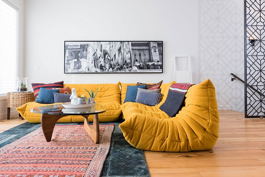 Plush Togo Sofa in bright yellow adds color to the sitting space